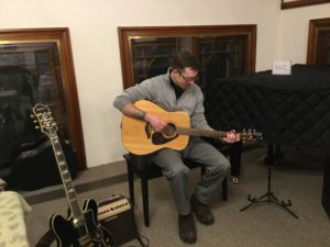 Quechee resident, Brian Gatch play beautiful acoustic guitar for the launch