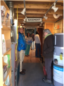 Local residents explore the Home Energy Makeover trailer sponsored by Sustainable Woodstock during last month's Button Up Day event