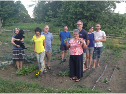 Sustainable Woodstock gardeners get ready at the Billings Farm community garden in Spring 2016.