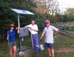 Cassidy Metcalf, SW Community Garden coordinator and Billings Garden gardeners, Brian Aspell and James McCarthy show off the new solar pump at the garden.